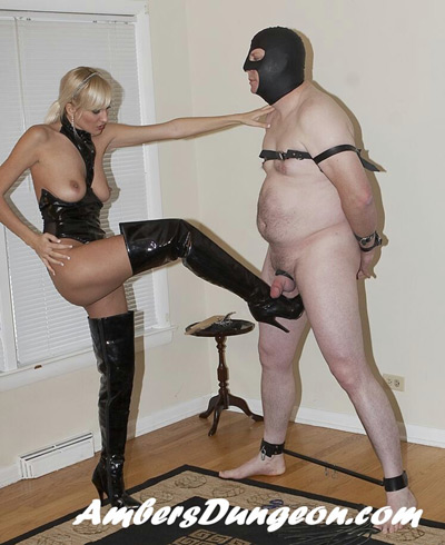 Ball busting the slave with her boots on
