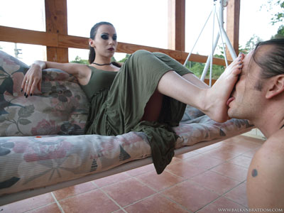 Mistress Bojan uses her slave's face as her foot support
