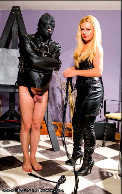 Hooded and half naked below at his Mistress's mercy