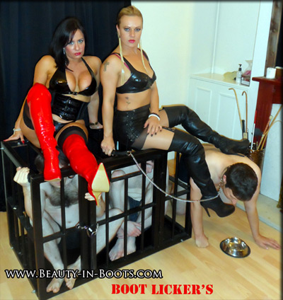 Releasing one of their caged slave to service her boots