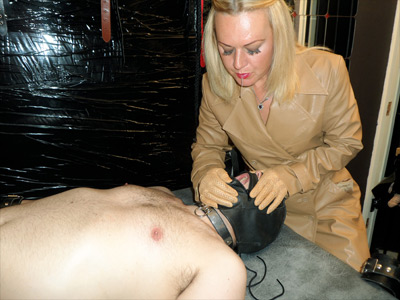 Spitting reward for the hooded slave
