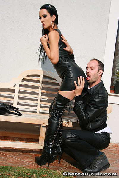 Worshipping leather ass of Liza outdoors