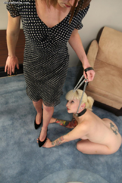 Stepping on the hands of her lowly slave girl