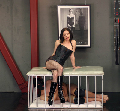 Caging her slave below her