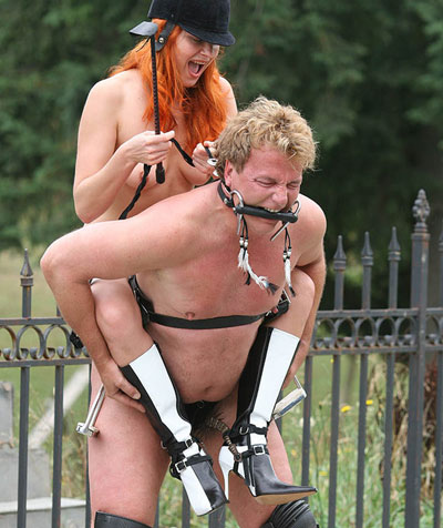 Spurring her pony slave on