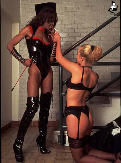 Mistress Clarissa gets attended by slave girl to lit up a cigarette