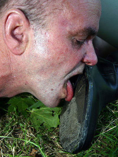 Outdoor muddy boot soles licking