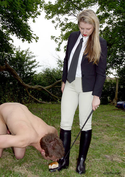 Riding Goddess feeds her slave from her riding boots