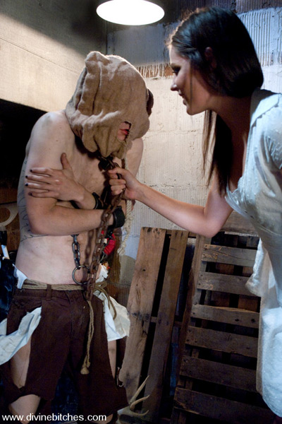 Shackled and hooded for her amusement