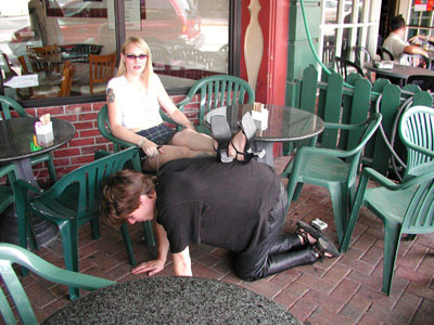 Foot stool for the Mistress at the cafe