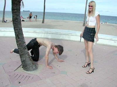 Ordering her slave to pee like a dog in public