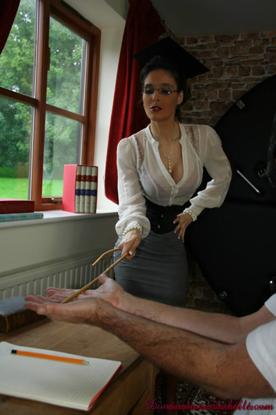 Strict disciplinarian canes on her student