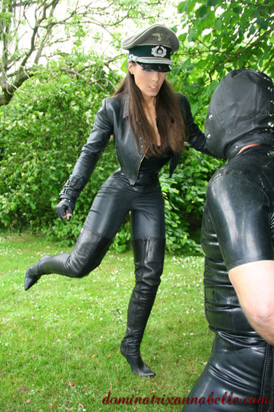 Ballbusting her hooded slave outdoors