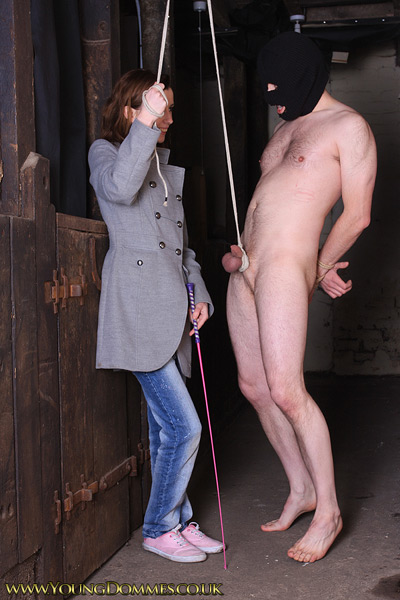 Walking her slave with the leashing by the cock