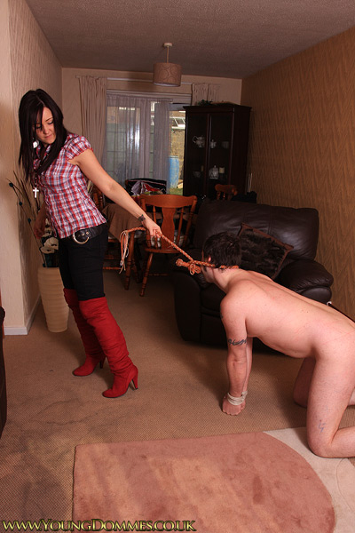 Bringing her tied up pony out for a walk