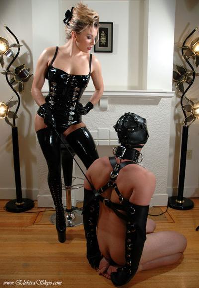 Mistress Elektra Skye disciplines her restrained slave