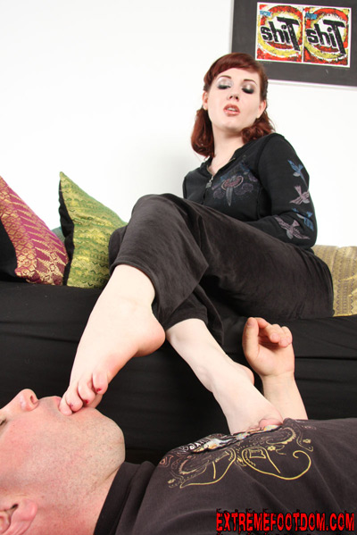 Forcing her beautiful bare feet into his mouth