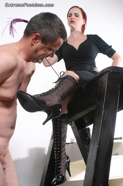 Tighten Mistress Berin's boot laces with his teeth
