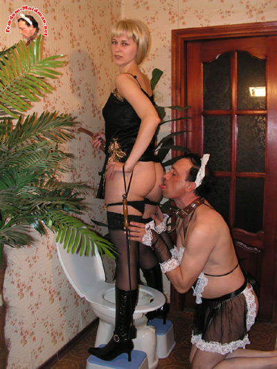 Maid man cleans up for the Mistress after toilet