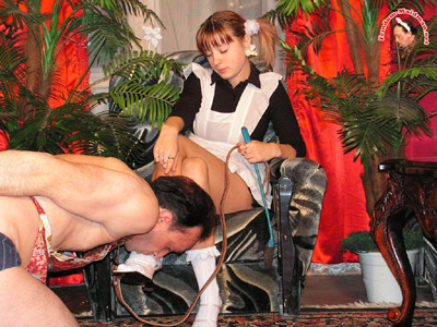 Down on his knees to greet his young Mistress