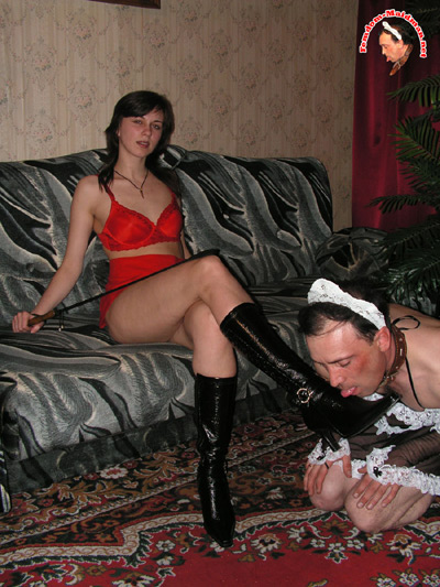 Maid man licks his Mistress's boots clean
