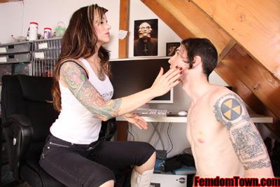 Mistress Athena slaps on her attending slave