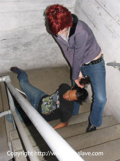Dragging her slave to a corner by his hair