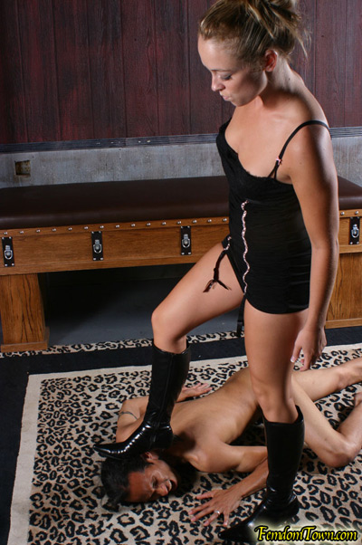 Stomping on the head of her slave
