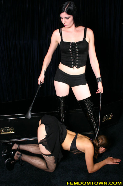 Mistress Indigo punishes her submissive slave girl