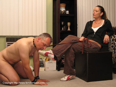 Cleaning Mistress Jude's sneakers