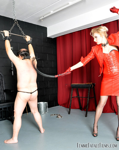 Restrained slave is the training target for his Mistress