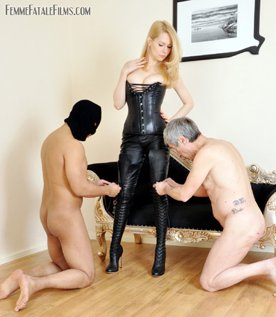 Helping their Mistress to lace up her dominatrix outfit