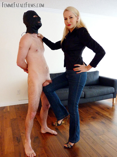 Busting on the balls of her hooded slave