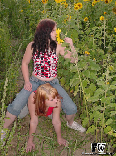 Riding her blonde slave girl around the flower farm