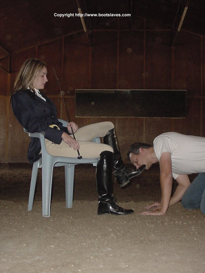 Cleaning Mistress Courtney's riding boots