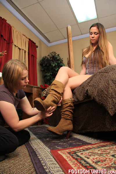 Mistress Amber gets her slave girl to assist her in changing boots