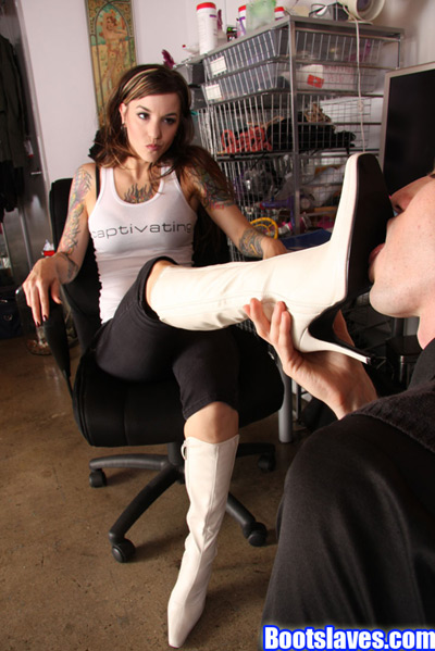 Mistress Athena demands every inch of her white boots cleaned