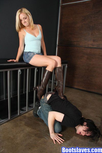 Digging her boot heels on her slave's back