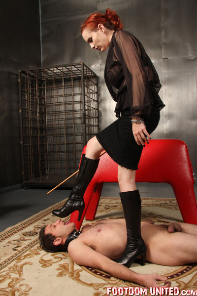 Begging to lick the dirt on Mistress Berlin's boots