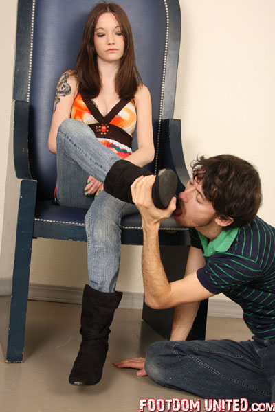 Licking Hunter's boot soles on her throne