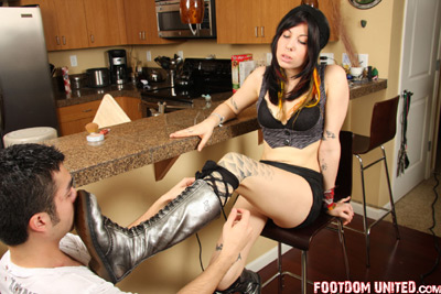 Boot support while her servant is lacing up her boots