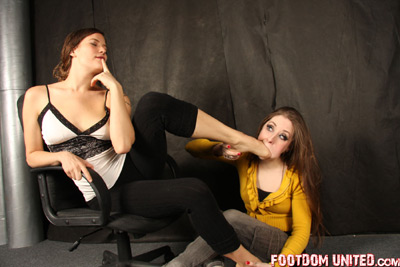 Gagging her slave girl for amusement