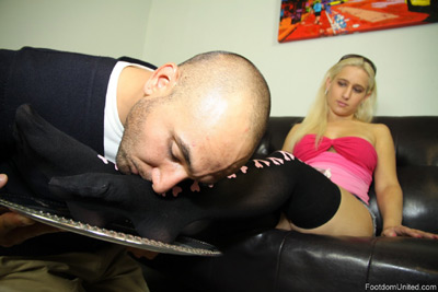 Mistress Sammi has her stockings feet pampered by foot slave