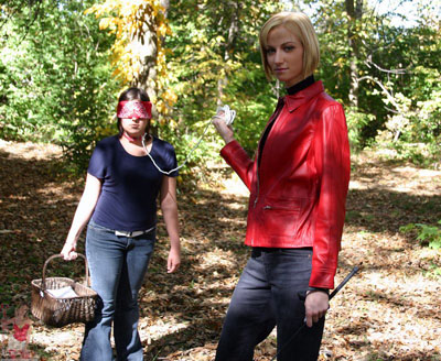 Goddess Giselle leads her leashed up slave girl for a picnic
