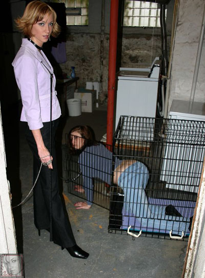 Releasing another slave from the cage for her amusement