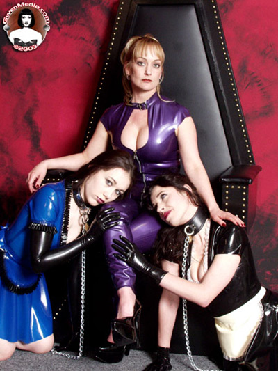 2 leashed up slave maids at the feet of their Divine Mistress