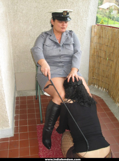 Cop Mistress forcing her slave girl to pleasure her
