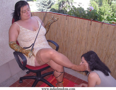 Indian Mistress slapping the slave girl with her foot