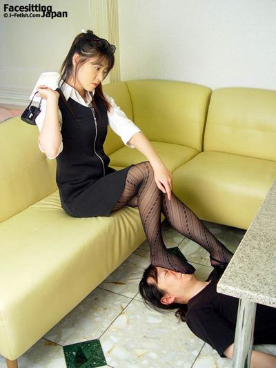 Lovely Japanese lady rests her sweaty stockings on her submissive's face