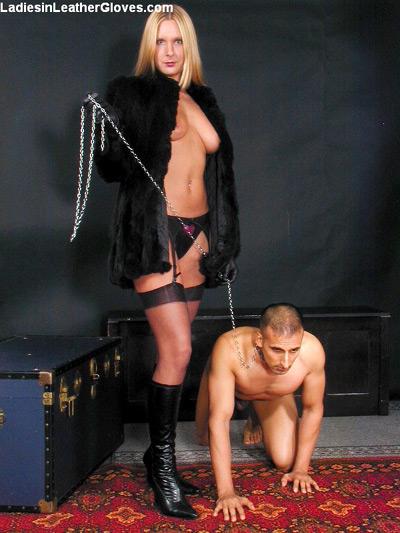 Bringing her leashed doggy slave for a walk